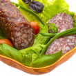 Ripe salami with salad — Stock Photo