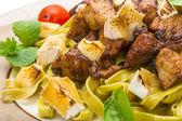 Tagliatelle with pork — Stock Photo