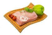 Raw pork with onion, basil and rosemary — Stock Photo