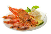 Spiny lobster, shrimps and rice — Stock Photo