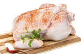 Raw chicken with paprika — Stock Photo