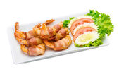 Shrimps in bacon — Stock Photo