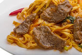 Fried noodles with beef — Stock Photo