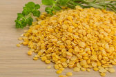 Raw yellow lentils — Stock Photo