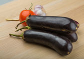 Eggplants on the board — Stock Photo