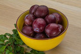 Plums in the bowl — Stock Photo