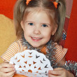 The happy girl with a paper snowflake — Stock Photo #1102103