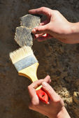 Archaeology: cleaning finds — Stock Photo