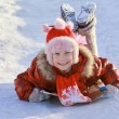 Girl sliding down frozen hill — Stock Photo #18676897