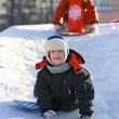Children slide down icy hill — Stock Photo
