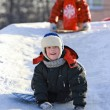 Children slide down icy hill — Stock Photo #18676905