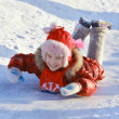 Girl sliding down a frozen hill — Stock Photo