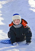 Kid riding a frozen hill — Stock Photo