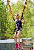 Girl jumping on a trampoline kangaroo — Stock Photo