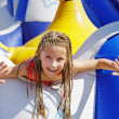 Delighted girl on inflatable attraction — Stock Photo