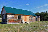 New house in the Siberian settlement — Stock Photo