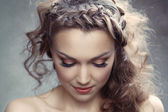 A pretty woman with curly hair — Stock Photo