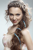 Attractive russian woman with long curly hair — Stock Photo