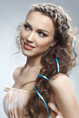Attractive woman with curly hair — Stock Photo