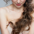 Pretty woman with long curly hair — Stock Photo