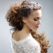 Beautiful woman with curly hairstyle — Stock Photo