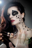 Beautiful woman with make-up and body-art styled as playing card — Stock Photo