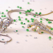 Stock Photo: Lizard brooch and butterfly brooch