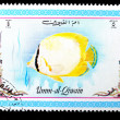 UMM-AL-QIWAIN: A stamp printed in UMM-AL-QIWAIN shows SEA FISH, - Foto de Stock