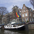 Gay pride flag over the channel in Amsterdam. — Stock Photo