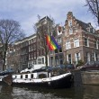 Gay pride flag over the channel in Amsterdam. — Stock Photo #26332881