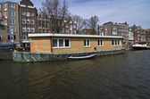 Barges on the canals of Amsterdam. — Stock Photo
