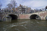 Bridges over the intersection of channels in Amsterdam. — Stock Photo