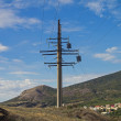 Power line pylon in the mountains. — Stock Photo