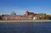 Old industrial building on the waterfront. — Stock Photo