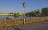 Railing of the bridge, completely hung with locks of love. — Stock Photo