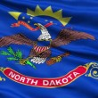 Waving Flag Of The US State of North Dakota - Stock Photo
