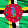 Waving national flag of Dominica - Stock Photo
