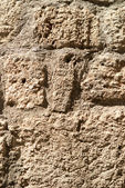 Ancient textured stonework background — Stock Photo