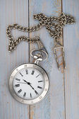 Vintage pocket watch with chain on table — 图库照片