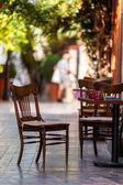 Empty coffee terrace with tables and chairs — Stock Photo