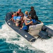 Stock Photo: Group of turists riding rubber dinghy