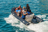 Group of turists riding rubber dinghy — Stock Photo