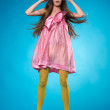 Surprised teen girl in a pink dress — Stock Photo