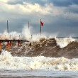 Stormy sea waves around the pier — Stock Photo