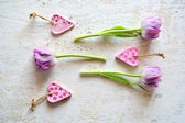 Purple tulips on an wooden background — Stock Photo
