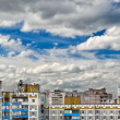 Stock Photo: Dramatic cumulonimbus clouds on blue sky over cityscape