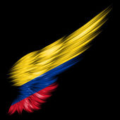 Colombia flag on Abstract wing with black background — Stock Photo