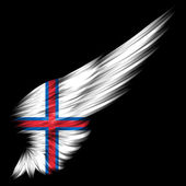 Faroe Islands Flag on Abstract wing with black background — Stock Photo