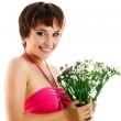 Young woman with wild flowers — Stockfoto #1095245