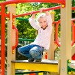 Girl on the playground — Stock Photo #14527419